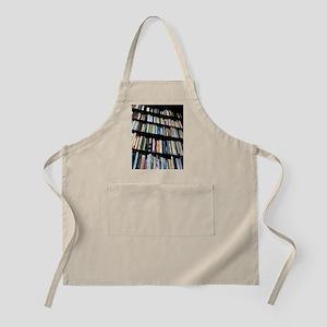 Books on bookshelves - Apron