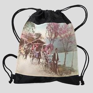 Rickshaws-by-Lake-Japan--C10326214. Drawstring Bag