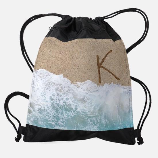 LETTERS IN SAND K Drawstring Bag