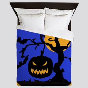 Scary pumpkin face hanging from tree Queen Duvet