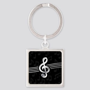 Stylish clef on musical note background Keychains
