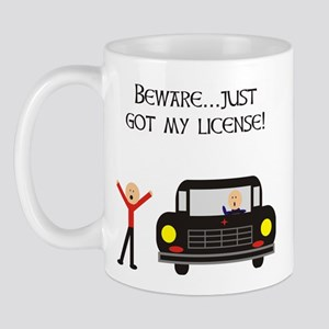 CAUTION NEW LICENSE Mug