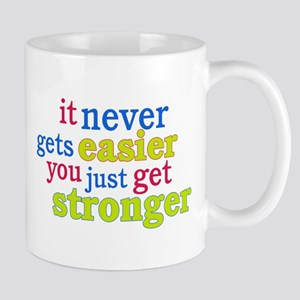 It Never Gets Easier, You Just Get Stronger Mug