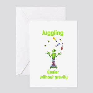 Juggling: Easier without gravity Greeting Card