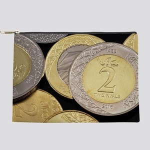 Assorted Saudi Arabian coins on a bla Makeup Pouch