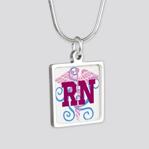 RN swirl Necklaces
