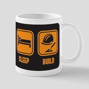 Eat Sleep build in orange with black background Mu