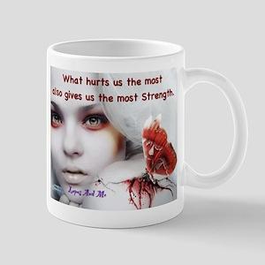 What hurts us the most Mug