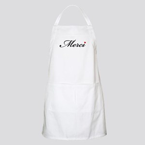 Merci, French word art with red heart Apron