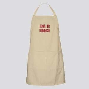 DUE IN MARCH Apron