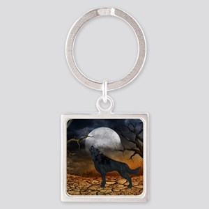 The lonely wolf in the night Keychains