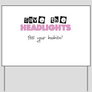 Save the headlights Feel the boobies Yard Sign
