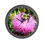 Bumble bee on Magenta Thistle Flower Wall Clock