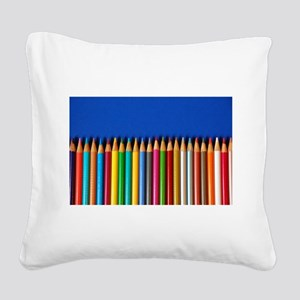 Colorful pencil crayons on blue background Square
