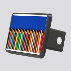 Colorful pencil crayons on blue background Hitch C