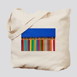 Colorful pencil crayons on blue background Tote Ba