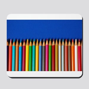 Colorful pencil crayons on blue background Mousepa