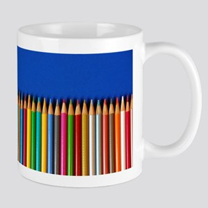 Colorful pencil crayons on blue background Mug