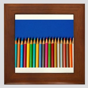 Colorful pencil crayons on blue background Framed