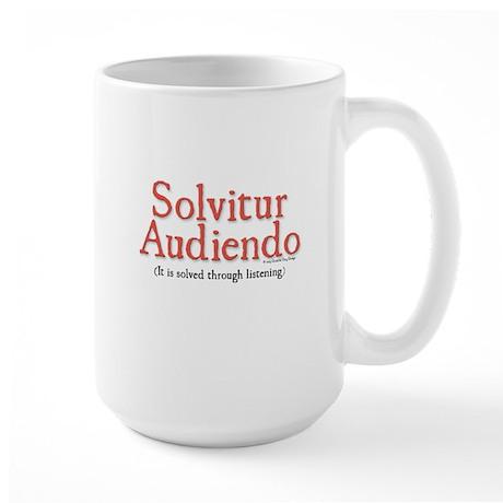 Solvitur Audiendo (it is solved through listening)
