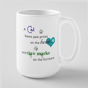 A cat leaves paw prints... Large Mug