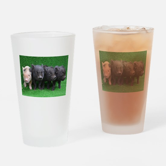 4 micro pigs in a row Drinking Glass