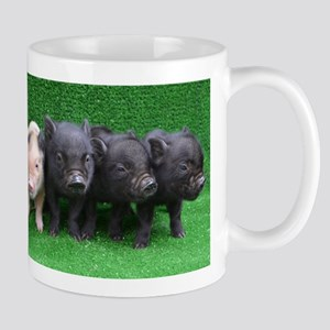4 micro pigs in a row Small Mug