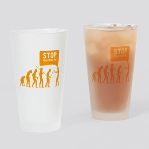 Evolution is following me Drinking Glass