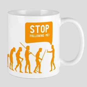 Evolution is following me Mug