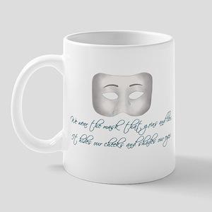 We Wear the Mask Mug