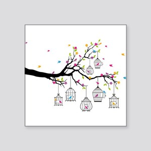 tree branch with birds and birdcages Sticker