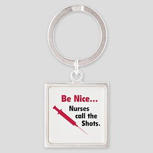 Be nice...Nurses call the shots. Square Keychain