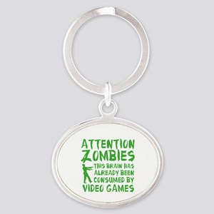 Attention Zombies Video Games Oval Keychain