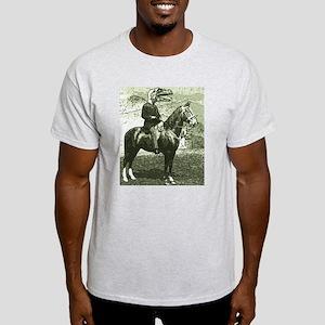 dinosaur man on horse T-Shirt