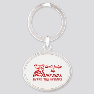 DONT JUDGE MY PIT BULL Keychains