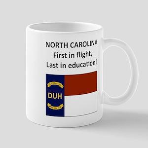 First in flight, last in education! Mug