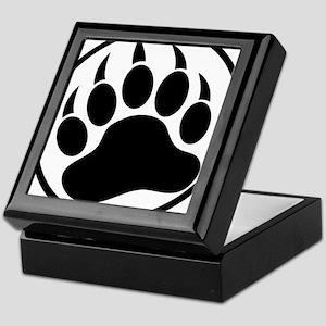 Classic black bear claw inside a black ring. Keeps