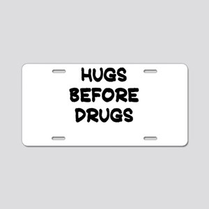 HUGS BEFORE DRUGS Aluminum License Plate