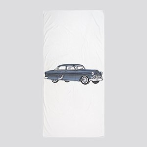 1953 car Beach Towel