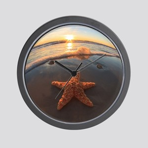 Starfish on Beach at Sunset Wall Clock