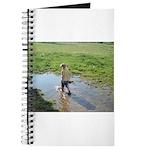Girl splashing Journal