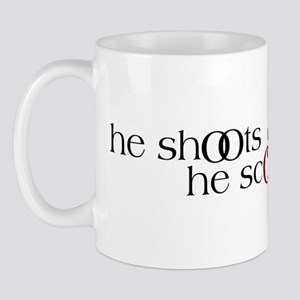 He Shoots. He Scores. Version III Mug