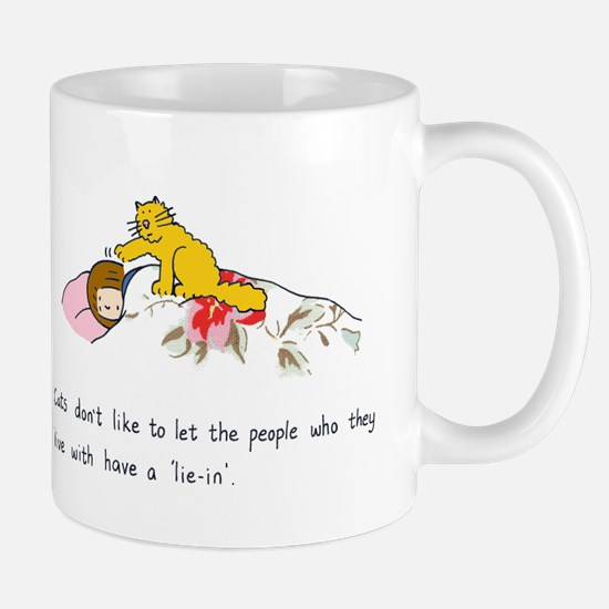 Cats don't like to let people 'lie in'. Mug