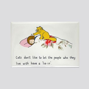 Cats don't like to let people 'lie in'. Rectangle