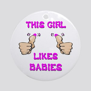 This Girl Likes Babies Ornament (Round)