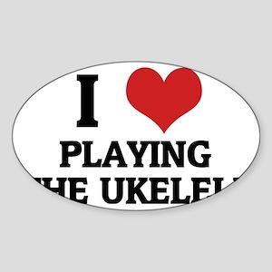 PLAYING THE UKELELE Sticker (Oval)