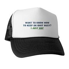 Keeping an idiot busy Trucker Hat