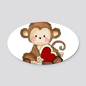 Monkey with candy Oval Car Magnet