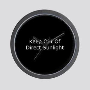 Keep Out of Direct Sunlight Wall Clock