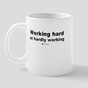 Working hard. Hardly working. Mug